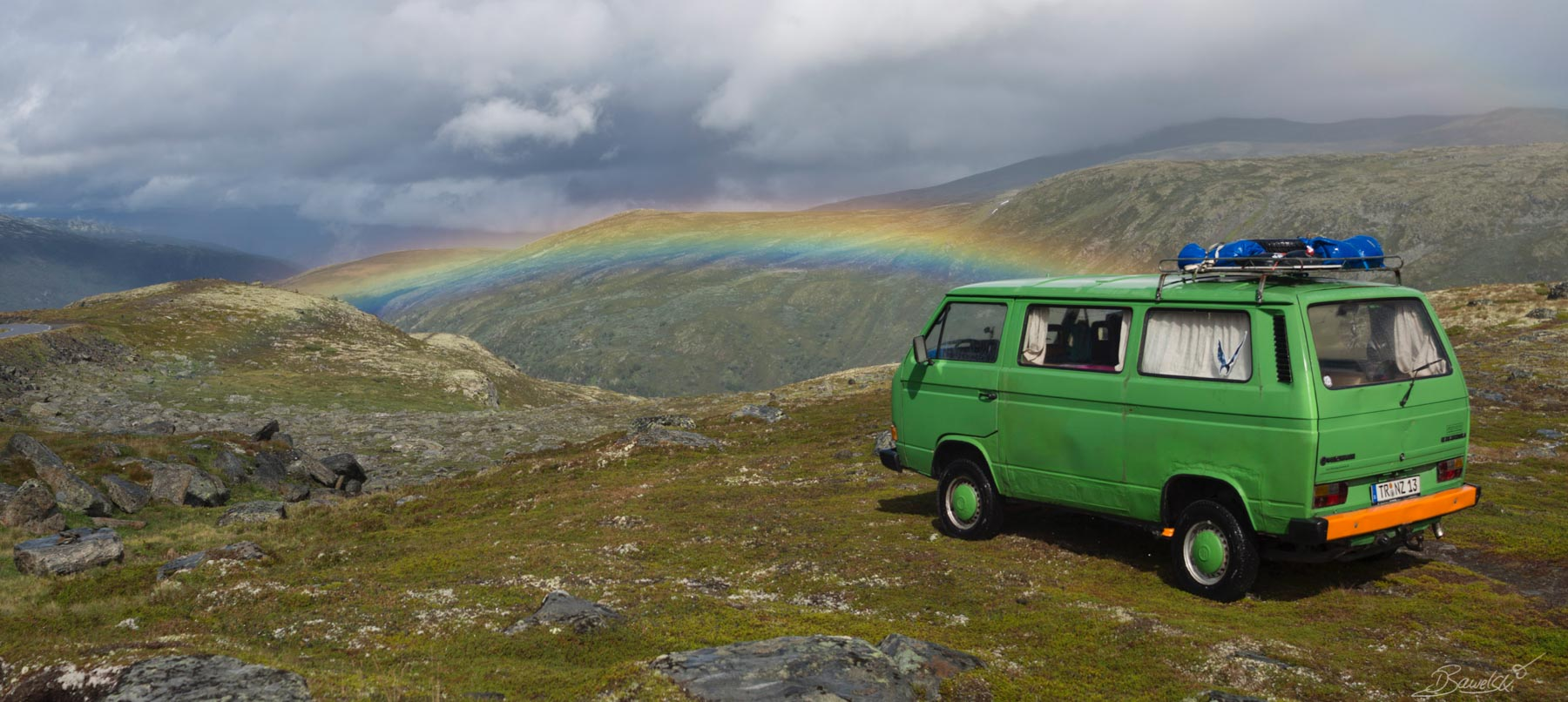 T3 Syncro on mountains with rainbow Vanlife